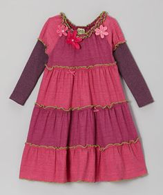 This sweet dress has a lot to offer the fashion-conscious kid. From its lettuce-edge tiers to its rosette embellishments, this enchanting piece is perfect for any occasion that requires a bit of extra style.