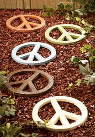 cast iron peace sign. Sold at LIVING PEACEFULLY. would be perfect for garden outside :)