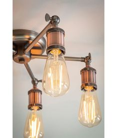 Industrial design with a modern twist. Perfect for above the ding room table! Industrial Ceiling Lights, Vintage Industrial Lighting, Rustic Lighting, Interior Lighting, Lighting Design, Industrial Design, Semi Flush Lighting, Semi Flush Ceiling Lights, Wall Lights