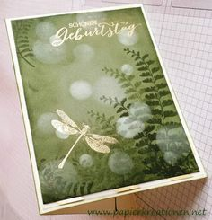 Bokeh-Technik zum Geburtstag Garden Green base with sponged forest Moss ink working in circles to the middle, where I left the color light, so that it becomes darker outwardly .Then I stamped the fern leaves and then dabbed the bokeh dots of light in white.Next embossed in gold the greeting and a dragonfly.