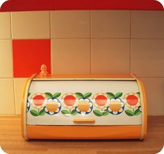Vintage orange flower bread box.