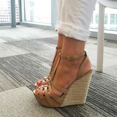 """Leather. Imported. Synthetic sole. Platform sandal featuring braided trim on wedge and strappy leather upper with buckle closure at ankle. Lightly padded footbed. """"I absolutely love these shoes! I normally wear a size 8 and the 8 fit like a glove"""" See: ALL REVIEWS"""