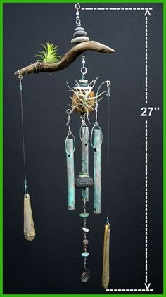 This is a very natural wind chime that has two Tillandsia air plants growing on it.     The driftwood, sea glass, and beach stones are all from a beach fronting the town of Hilo on the Big Island of Hawaii. ************************************************************    Hang Loose wind chimes are made to look like they were hanging there for ages. These chimes are made to age well and will look better with age. They are meant to be seen, gently heard, and make you feel good.    Mother nature…