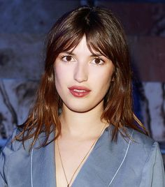 Jeanne Damas with effortless bed hair and side parted bangs