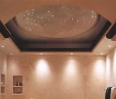 """Fiber Optic Star Ceiling - """"The dome detail above the whirlpool sparkles with fiber-optic stars, while recessed downlights along the perimeter give off light reminiscent of comets hurtling toward the heavens."""" Lighting Design Sourcebook: 600 Solutions for Residential and Commercial Spaces Paperback by Randall Whitehead"""