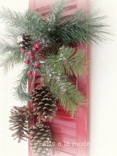 old shutter christmas door decoration, christmas decorations, repurposing upcycling, seasonal holiday d cor, I bought an evergreen spray at Joann s and it already had the pine cones hanging from it PERFECT