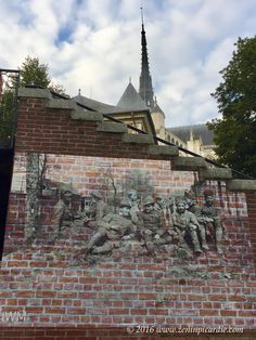 """""""Amongst Us"""", portraits representing the 25 nations that fought in the Battle of the Somme, found on walls throughout the city of Amiens, France.  Until 18 November 2016."""