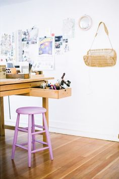 This purple stool adds a pop of colour against the white walls and wooden floor. Perfect! #hotlooks