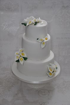 All White Wedding Cake with hand made Cala Lillies by Sweet Bliss Bakes