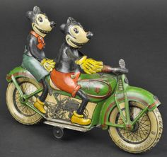 "MICKEY AND MINNIE MOUSE RIDING MOTORCYCLE Tipp & Co., Germany, c. 1930's, lithographed tin, a visually stunning toy, as famed comic pair is depicted astride a motorcycle with working clockwork mechanism; long considered the most sought after example to complete the Disney line, the extensive graphics and overall colorful tones are matched only by the toys well documented rarity. 9 1/4"" l."