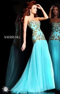 Nothing screams elegance quite like a simplistic, classic mermaid dress like Sherri Hill 2973! This silhouette is universal, making this dress a no brainer on the fit! From the regal gold detailing throughout the bodice to the skirt that is comprised of layers of chiffon, this is meant for a princess! The hemline hits longer in the back in a short of train. We love this style and its classic grace! A perfect investment into your wardrobe.