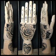Wooden hand mannequin with original drawing of a rose and