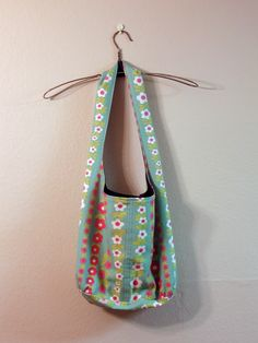 Reversible Shoulder Bag Tutorial — Sew DIY --updated tutorial. It's put together with only four pieces of fabric and should be easy enough for an advanced beginner to complete. The finished size is 27 inches tall and 35 inches around.