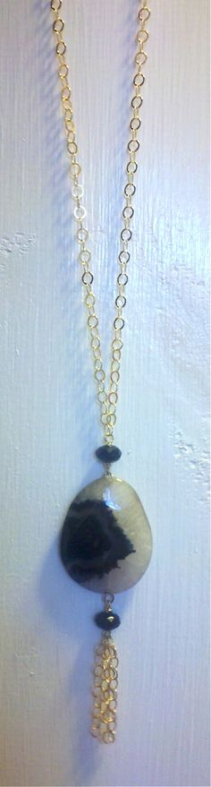 long s dot jewelry gold necklace with black and white agate pendant, black crystals and a fun tassle!