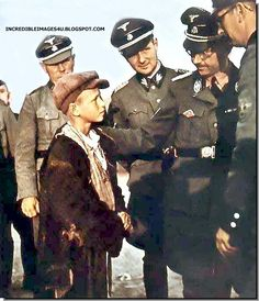 Heinrich Himmler on a visit to Poland talks with a little Polish boy