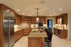 Beautiful maple with a stain glaze finish, Italian granite & porcelain tile back - traditional - kitchen - new york - Cabinet Artistry
