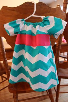 Adorable, Affordable Baby Doll Style Dress w/ Ribbon Embellishment by Mel'n'Tri Boutique, $15.00. I will never be able to decide between the pink and the blue.