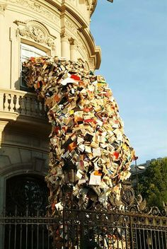 Enormous Sculptures of Books exploding out of buildings, via Flavorwire #Musetouch Visual Arts Magazine