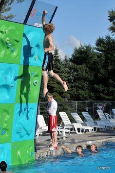 boy jumping off wall