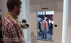 Stand in front of a large display while your image is projected on it to sample different outfits.   #fashion #Toshiba #CES2015