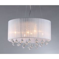 Add some elegance to your home with this silver-finished Spherical crystal chandelier. This dynamic lighting element features generous rows of cascading crystals to catch the light.