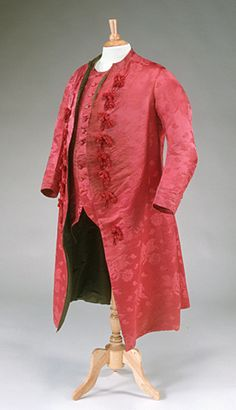 Man's banyan (nightgown, dressing gown) and waistcoat, England (Spitalfields), 1760-1770. Cherry-red silk damask with a large scale floral motif, tassels, dark green silk lining.