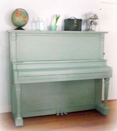 10 Pretty Painted Pianos - guess I'm not the only one who has dreamed of painting my old piano a fun color...