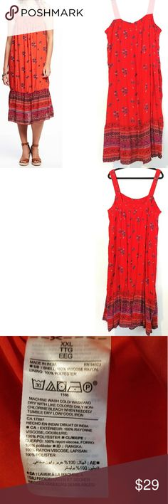 """XXL OLD NAVY Red Smocked Gauze Swing Dress - NWT This XXL Old Navy Smocked Crinkle-Gauze Swing Dress for Women is NEW With Tag. Lined. Smocked neckline. Bust measures 22"""" across laying flat measured from pit to pit so 44"""" around unstretched. Stretches to about 27.5"""" -- up to 55"""" around. About 50"""" long. Navy Blue floral print on red. NEW!!! ::: Bundle & save! ::: No trades. ::: Model pic from OldNavy.com ::: Old Navy Red Boho Gauze Dress Old Navy Dresses"""