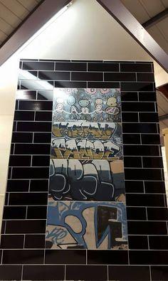 Tile Display With Graffiti Tiles And Black Brick