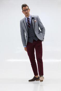 Mens Fashion - Blue blazer with navy trim, blue oxford shirt, striped tie, green tie clip, polka dot vest, floral pocket square, navy lapel flower, burgundy trousers, 2 tones shoes