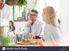 Download this stock image: Smiling man enjoying lunch at cafe table - FR5J1D from Alamy's library of millions of high resolution stock photos, illustrations and vectors.