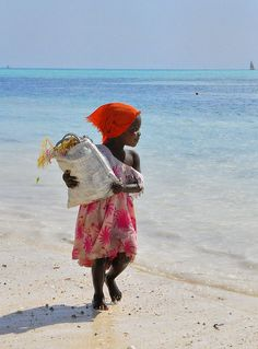 This little girl is a seaweed collector in Zanzibar. I love her head scarf :))