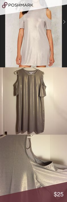 BRAND NEW!! Glamorous brand metallic dress! New and never worn beautiful metallic slinky dress! Fabric is stretchy and the shoulders are open. In the light the fabric has a pretty gold shimmer to it. Very comfy and sexy! Size large. Bottom of dress is not hemmed shown in pic 4. *not bebe, similar vibe, brand is called Glamorous. bebe Dresses Mini