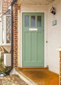 1930s front door with three pieces of glass.   Door painted light green