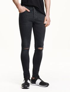 jeans in washed stretch denim with ultra-slim legs and a regular waist.