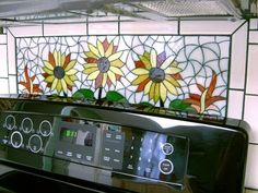 Great idea for behind my stove. Glass Mosaic Tile Art: Make a Glass Mosaic Tile Backsplash 08
