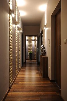 Use brick veneers or other texture on boards, then fastened to wall to create divisions and/or stripes for texture and color - 8 Creative Ideas For Your Hallways