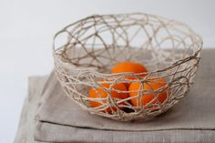 Use string and fabric stiffener to make this bowl.