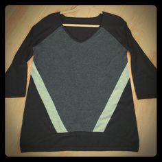 Gray and Black sweater 3/4 sleeve snd slighter longer in the back.  Very classy & flattering fit Sweaters V-Necks