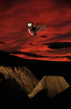 ♂ Extreme sport adventure Mountain Bike Jumps over red sky