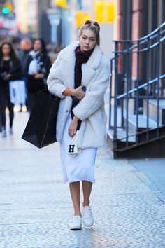 Hadid News || Your best and ultimate source for all things about the Hadid sisters  - October 19: Gigi Hadid out in Soho in New York...