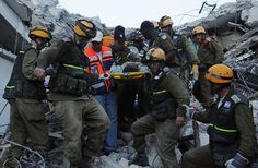 Reserve soldiers of the IDF's Search and Rescue Unit save a man from a government building that collapsed during the disastrous earthquake that hit Haiti in 2010.