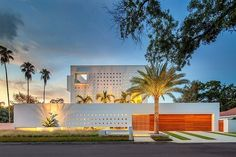 tall-private-florida-home-with-open-indoor-outdoor-hallways-1-front-night.jpg