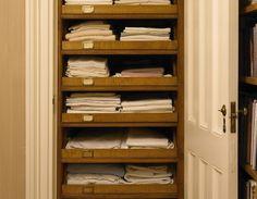 Linen closet pull out shelves
