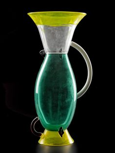 Amphora of clear bluish-green, colourless, yellow and deep red glass and opaque white and black glass: Italian, Venetian, Murano, designed by Ettore Sottsass of Memphis srl, by Toso Vetri d'Arte, 1982.