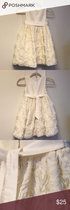 AMERICAN PRINCESS Dress Stunning little girl formal Ivory dress with back zip and sash for tying. Layered for fullness this sleeveless dress has some snag/pulls on back and very minor spots - please see photos. Worn once only and perfect for a special occasion or holiday. Size 6. American Princess Dresses Formal