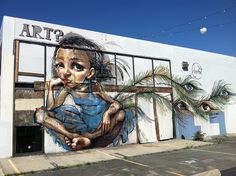 We miss this lovely mural by renowned German Street Artist Herakut... The building at National and Washington has since been torn down.