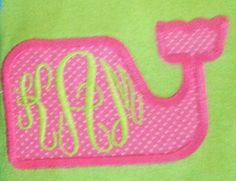 Whale applique with monogrammed initials.