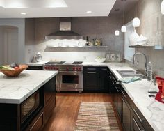 I have had a lot of readers ask me about our kitchen countertops over the past year. They are Carrara Marble slabs from Dominion Granite. I love having marble in our kitchen, but I also don't mi Marble Kitchen Worktops, Granite Kitchen Counters, Formica Countertops, Black Counters, Formica Laminate, Kitchen Cabinets, Kitchen Laminate, Cement Counter, Bathroom Countertops