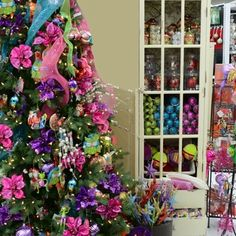 A whimsical tree in bright jewel tones with quirky animals makes Christmas fun!